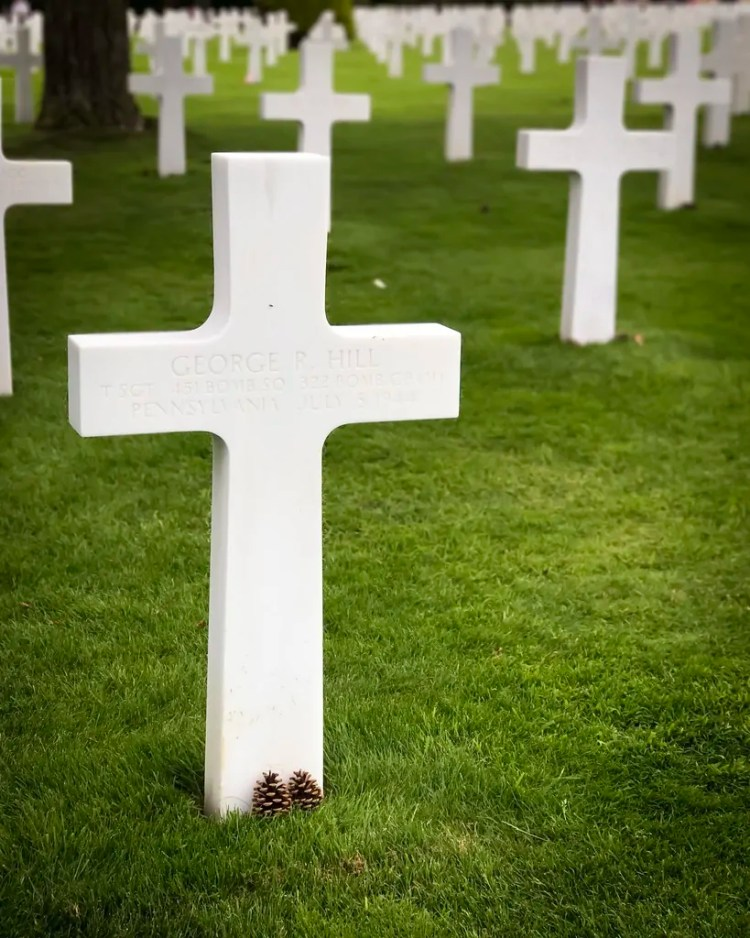One of the nearly 10,000 gravemarkers at Normandy American Cemetary.