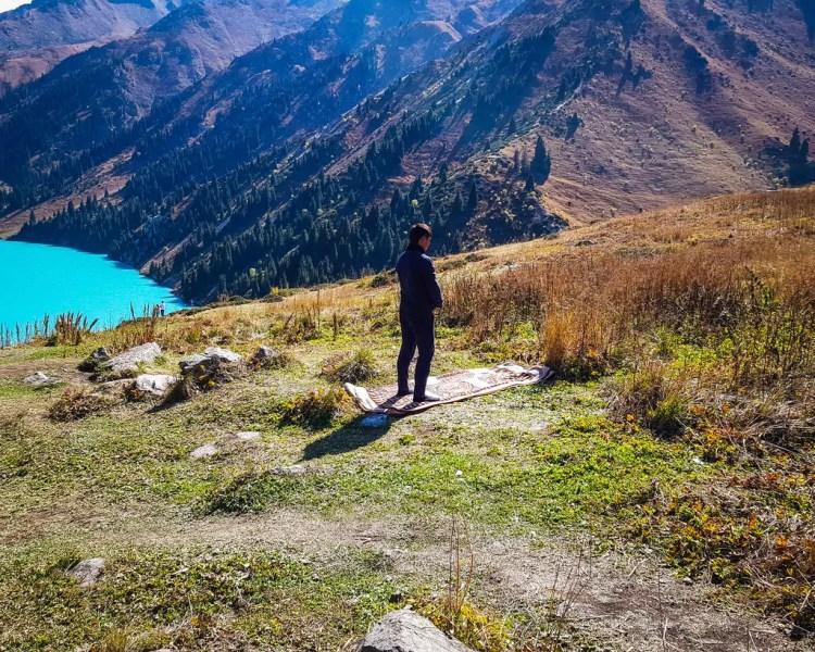 Big Almaty Lake - A Kazakh Muslim stopping to pray in the beautiful surroundings of the lake