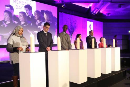 Candles lit by survivors of various genocides; Amouna Abdelbarl, Safet Vukalic, Eric Eugene Murangwa, Sophari Ashley, Ladislav Balaz and Lily Ebert