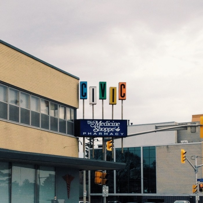That sign. That legendary sign. It has been a presence on the corner of Carling and Holland since 1960. Photo: April 2014.