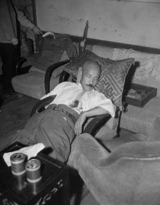 This photo was snapped as American soldiers stormed Tojo's home to arrest him. The former Prime Minister attempted to shoot himself in the chest, but survived to stand trial.