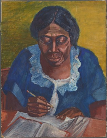 Woman seated at table, looking at book, pencil in hand, about to something