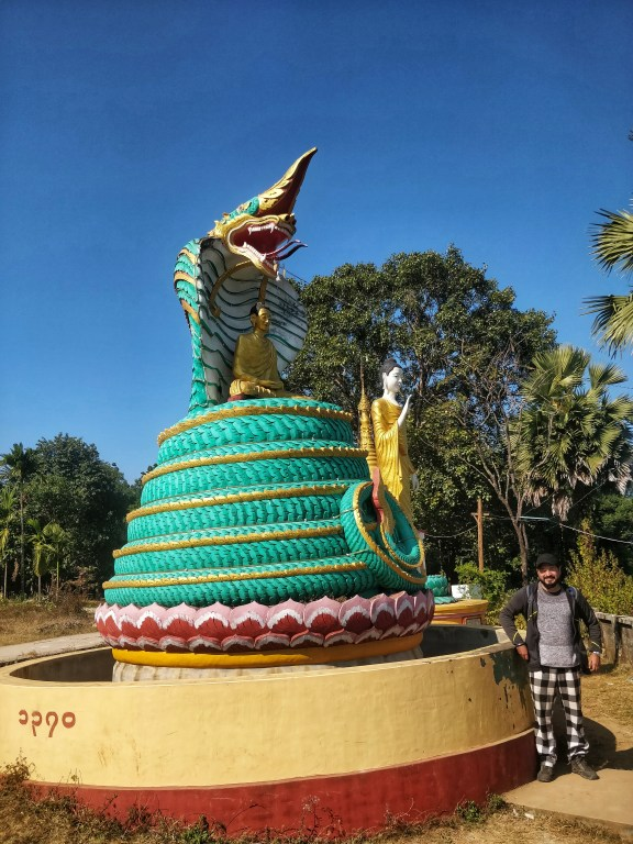 A buddha statue with pagoda tops covered in gold
