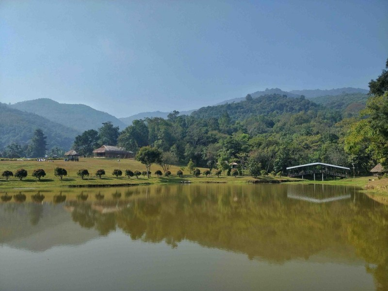 A water reservoir in Andro Shanthei National Park with a backdrop of the charming Baruni Hills