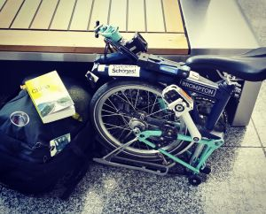 Brompton on the plane, folding bike plane, brompton checkin
