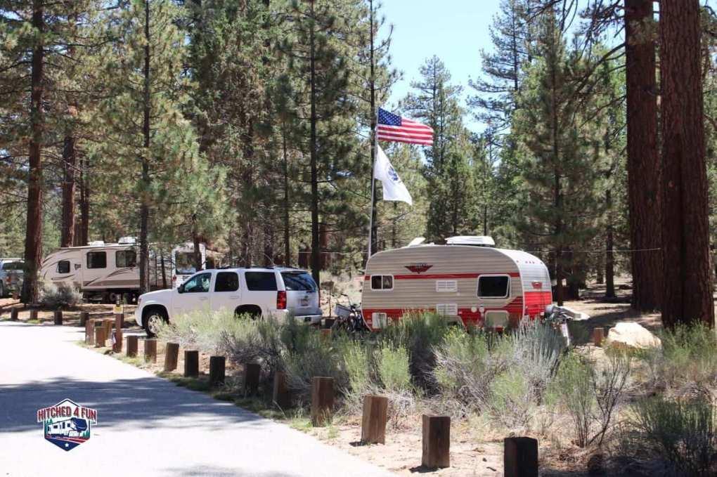 Retro Trailer and flag at Heart Bar Campground, Big Bear Lake, CA