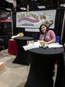 Getting tables set up for the Bee Lives booth at Gen Con