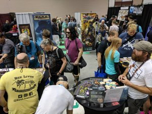A busy booth for Bee Lives at Gen Con