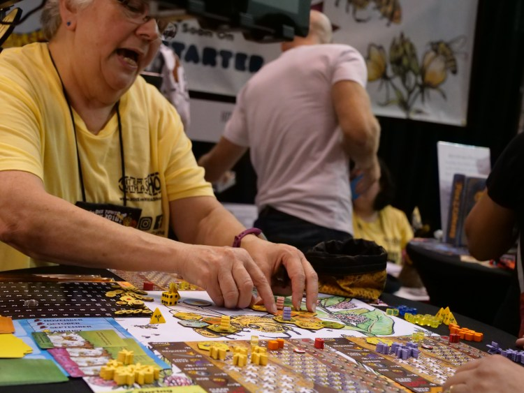 Sally Shoemaker teaches people how to play Bee Lives We Will Only Know Summer at Gen Con 2018