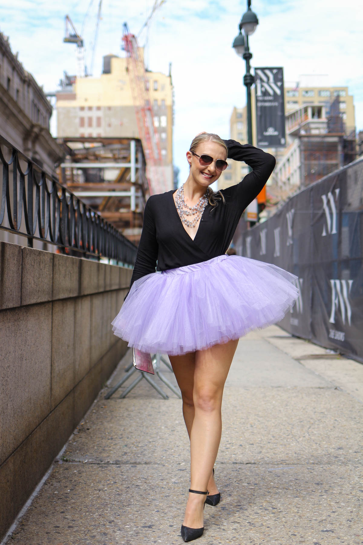 Allyn Lewis of The Gem in a tutu and long sleeve romper look at New York Fashion Week.