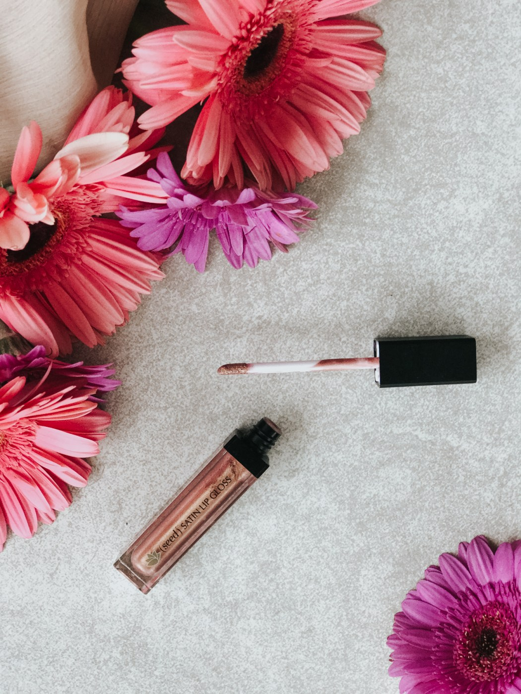 Seed Body Care's Satin Lip Glass softens your lips, is packed with nourishing seed ingredients, and the colors are GORGEOUS. It's also cruelty-free, paraben-free, phthalate-free, and lead-free. This all natural lip color gives a subtle, satiny shine.