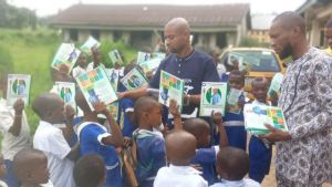 Ukwa East Councillor gift educational materials to pupils, teachers