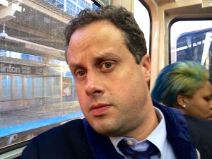 A selfie of Jeff McCarter pondering this blog post while looking out the window of a CTA El train.