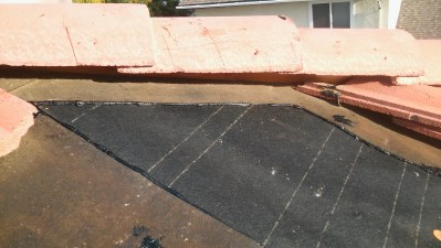 Roof with new tar paper put down.