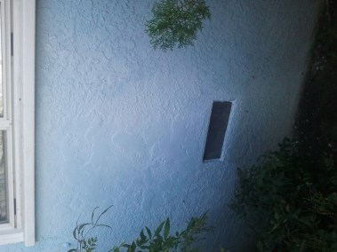 Wall after repair and painting.