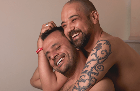 gay men smiling and embracing