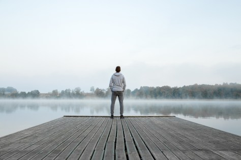man standing alone on a dock