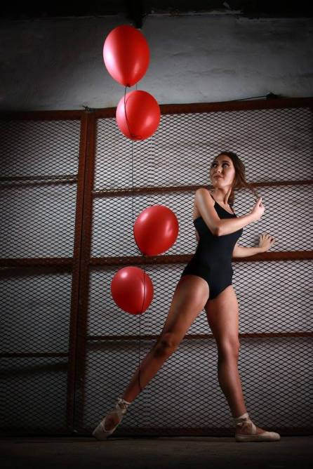 Balloons tied to Ballet Dancer