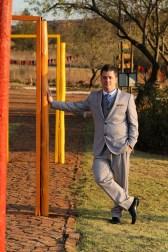 Groom in Grey Suit and Blue Tie