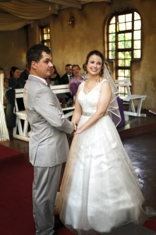 Bride and Groom in Church holding hands