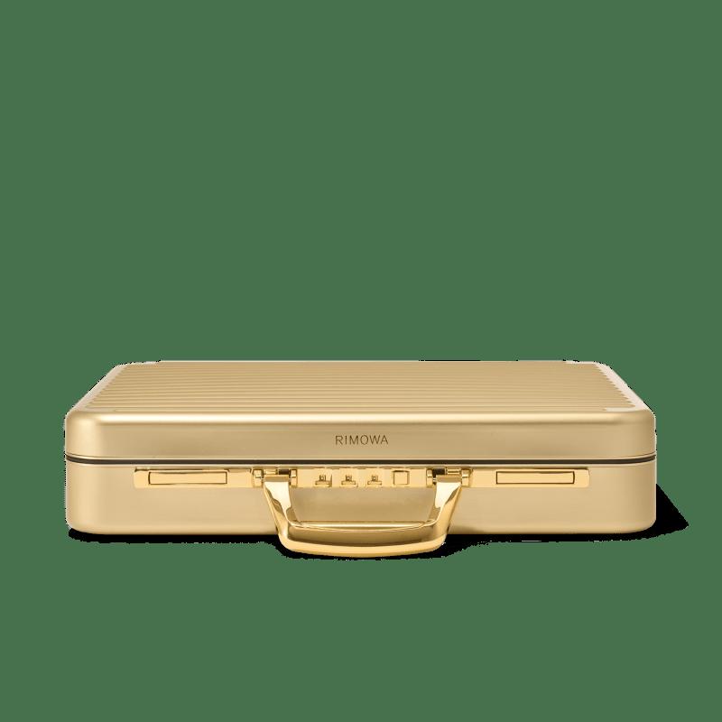 RIMOWA 推出全新 Attaché Gold 限量手提公事包