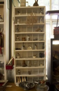 Compartments hold a variety of found objects