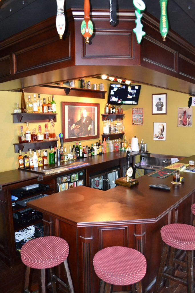 Custom bar in game room addition by HK Construction