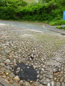 Tarmac on cobblestones at Dodge Hill - not conservation area appropriate!