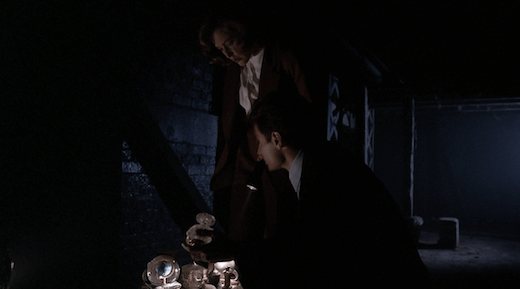 Mulder and Scully look at evidence in Squeeze