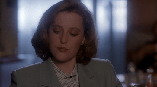 Scully sits primly at breakfast while Mulder talks like a crazy person.