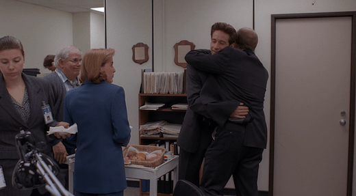 Jerry hugs a surprised but pleased Mulder.