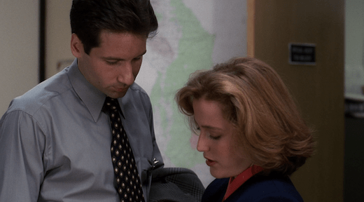 Mulder and Scully crowd each other's personal space.