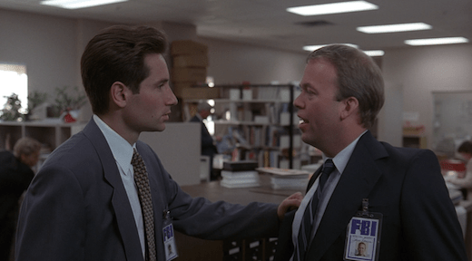 Mulder confronts Jerry, grabbing the lapel of his coat.