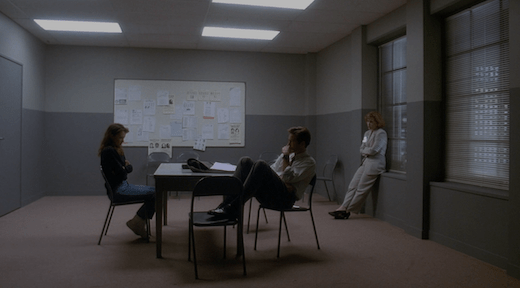 Lauren, Mulder, and Scully sit in an interrogation room.