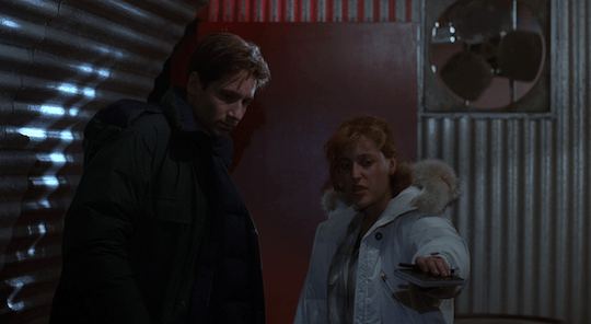 Mulder and Scully argue about how best to keep others safe from the parasite.