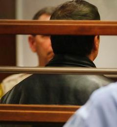 Scott Schenter turns his back to avoid being photographed at his arraignment Friday afternoon. Photo by Brian van der Brug, Los Angeles Times (Pool)