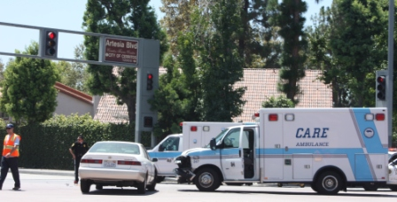 Ambulance, car collide in Cerritos