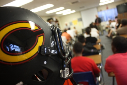A room of angry players, parents and community members square off with Cerritos High School officials Wednesday night in a campus classroom.