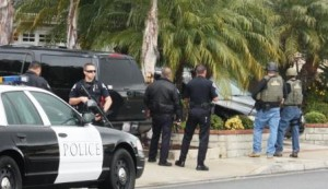 US Marshalls, and members of the Irvine Police Department serve search warrant at the home of Chris Dorner on Friday in La Palma.  Randy Economy Photo