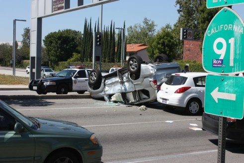 Three car crash in Cerritos on Monday morning in front of the Los Cerritos Community Newspaper officers at Shoemaker and Artesia.