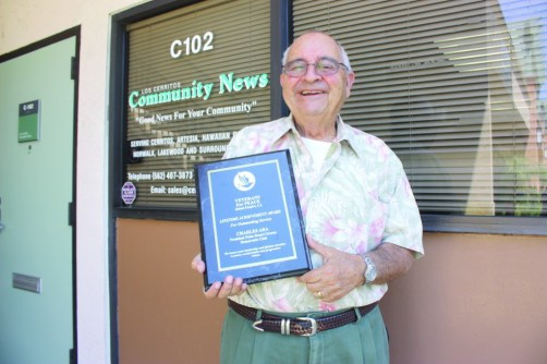 Caption: Charles Ara shows his Lifetime Achievement Award from the Veterans For Peace in front of the Los Cerritos Community Newspaper office this past Wednesday.  Randy Economy Photo