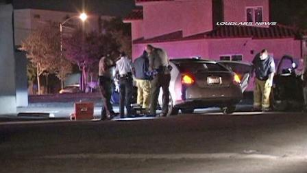 Authorities investigate a car where a man later identified as Christian Rodriguez, 49, was found shot to death in Norwalk on Sunday, Dec. 1, 2013. (KABC Photo)