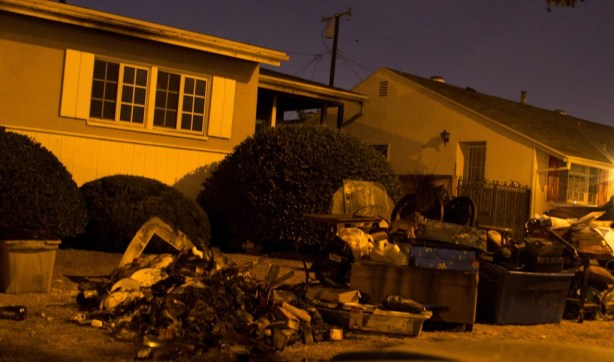 Charred possessions are all that remain from the home on Cornuta in Bellflower.  Photo by DaMan for HMG-CN