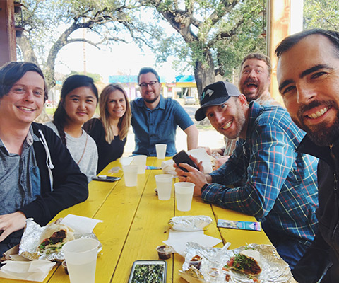 The HMG Creative team enjoying some tacos together