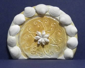 five inch round hobbit door, carved and embellished with seashells