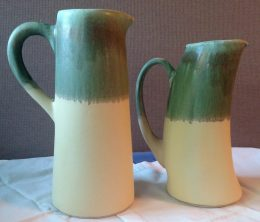 two yellow and green pitchers, unavailable
