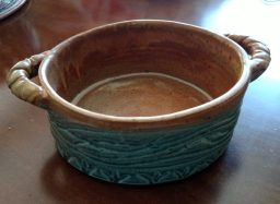 small round carved casserole dish