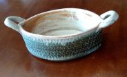 small oval carved casserole