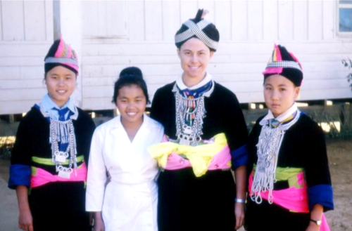 Nurse Dee Dick, in Hmong New Year dress with Goua Lor, the dynamic head nurse Choua Thao and Song Chow.  Photo credit: