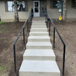 Metal Raillings with Concrete Stairway